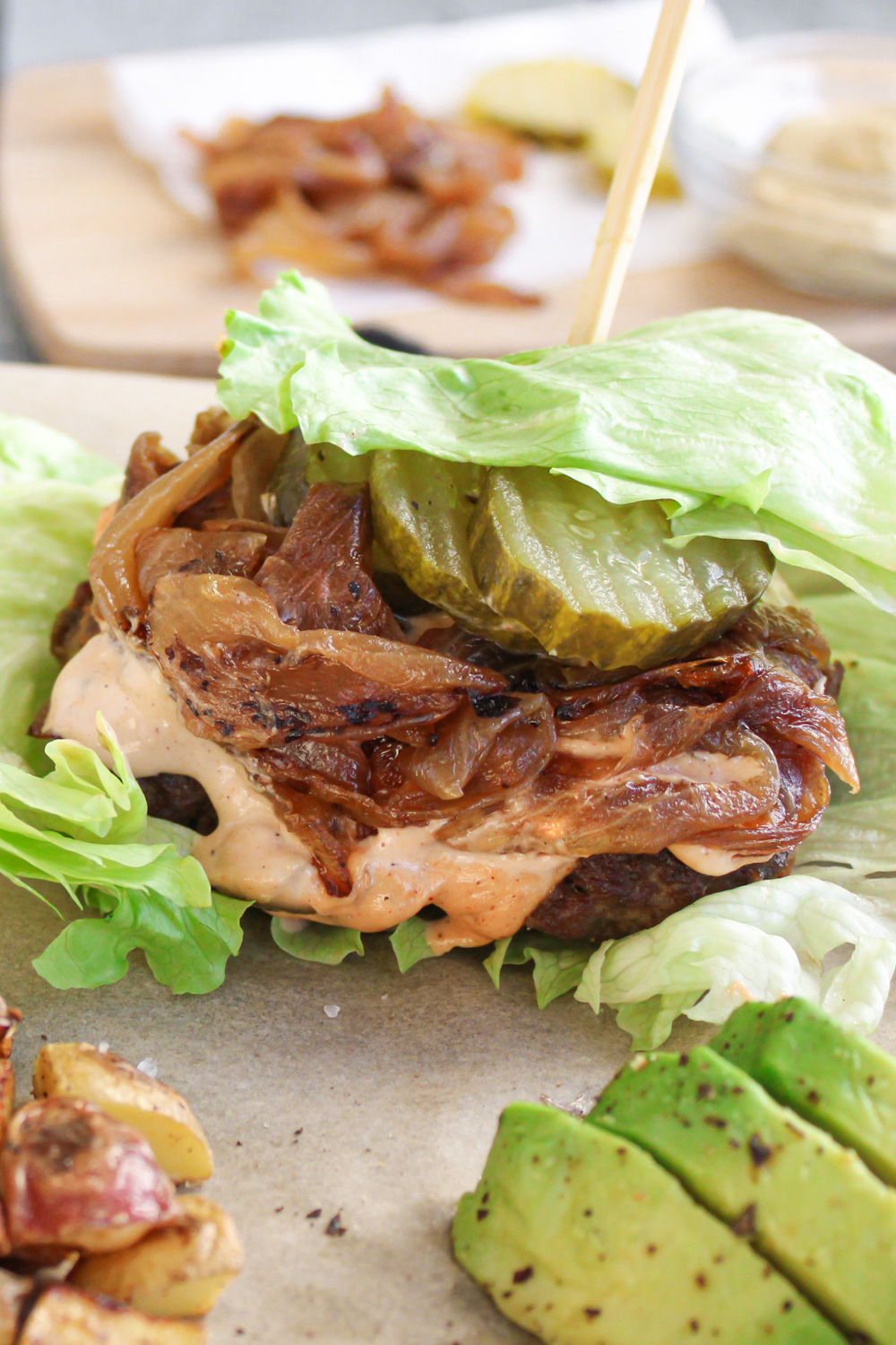 in N out burger topped with lettuce