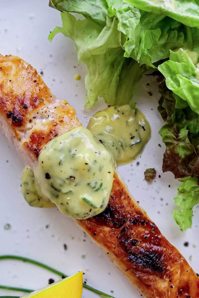 salmon with herb sauce on plate