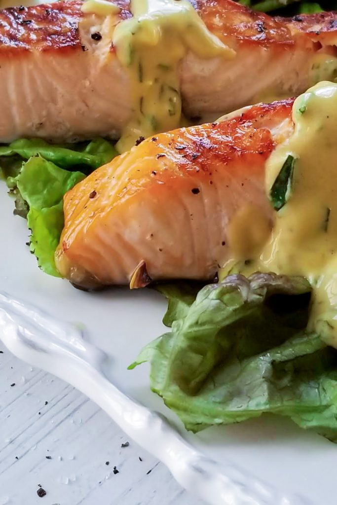 2 salmon on plate with sauce