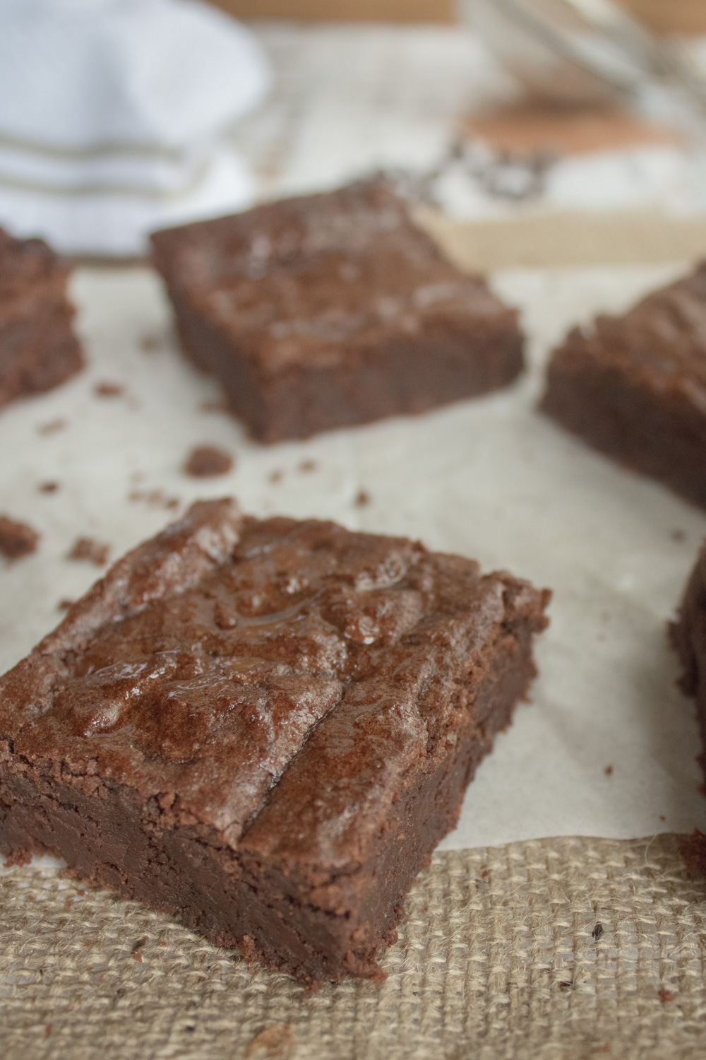 3 brownies on parchment
