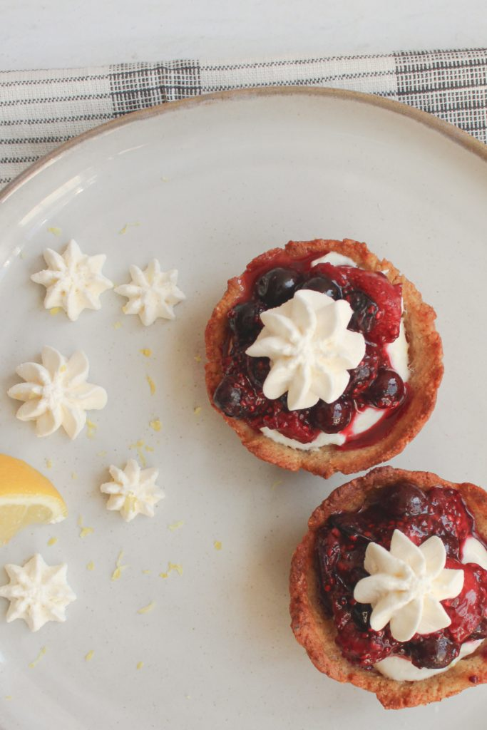 2 cheesecake cups with whipped cream stars