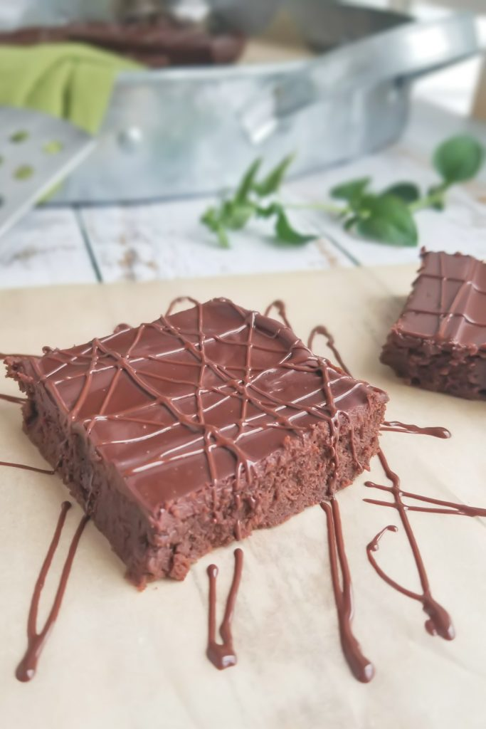 2 mint brownies on parchment