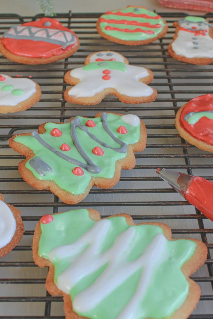 sugar cookies on tray with piping bag