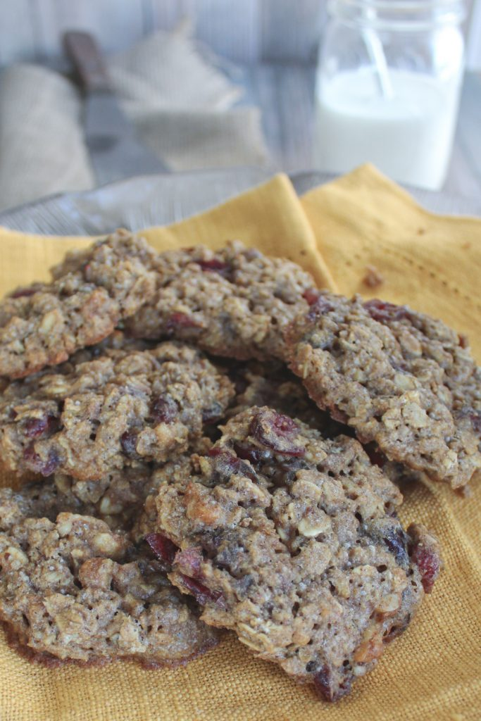 oatmeal craisin cookies healthy on plate with milk