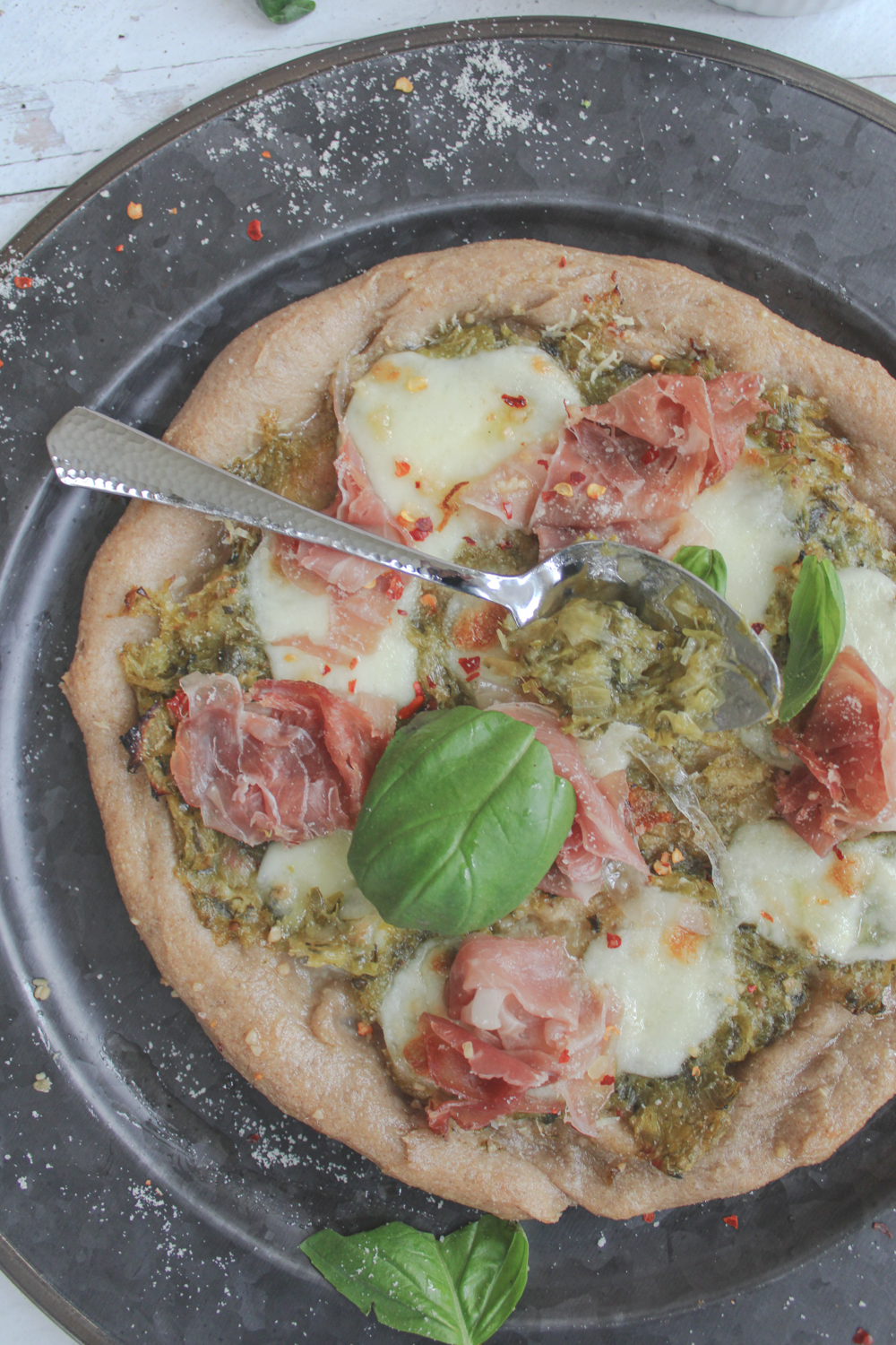 healthy homemade pizza with spoon of leek confit