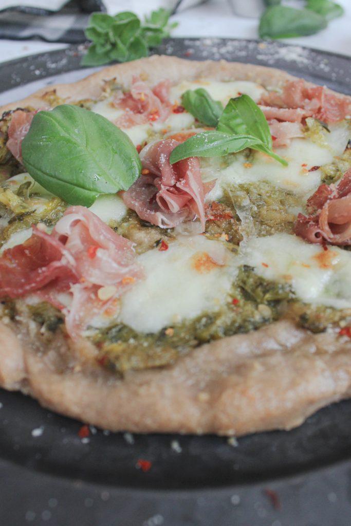 angle photo of leek confit pizza
