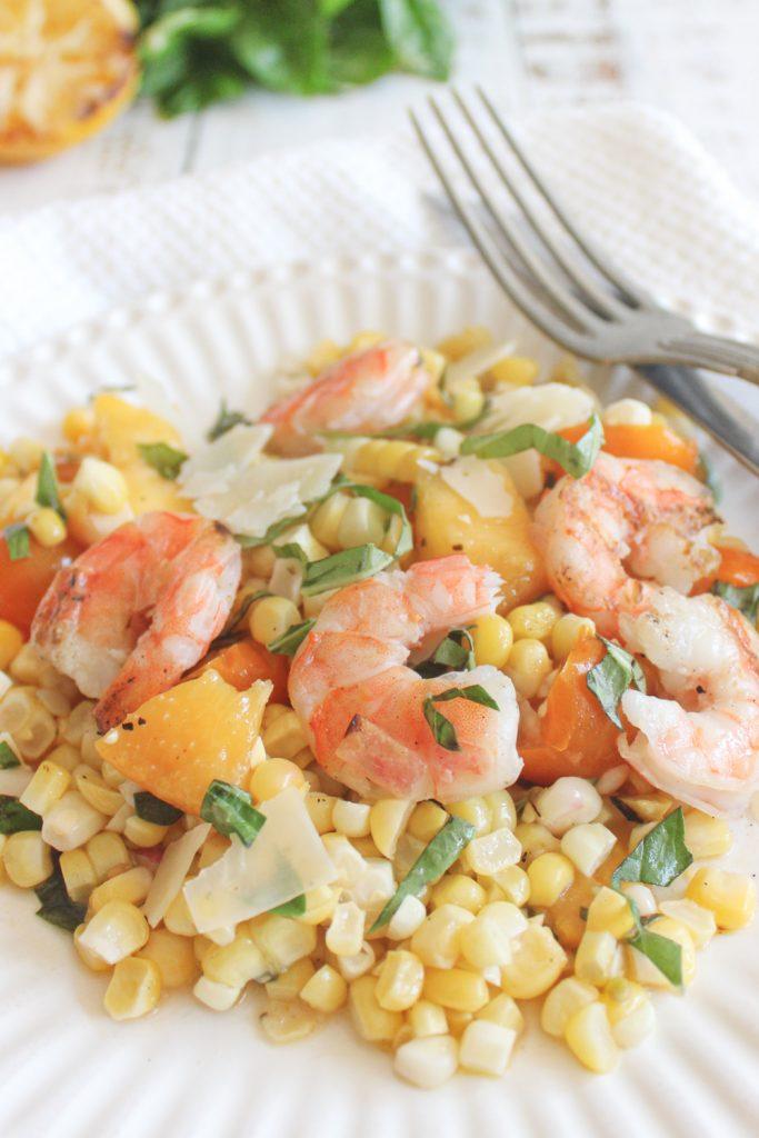 shrimp on corn salad with fork
