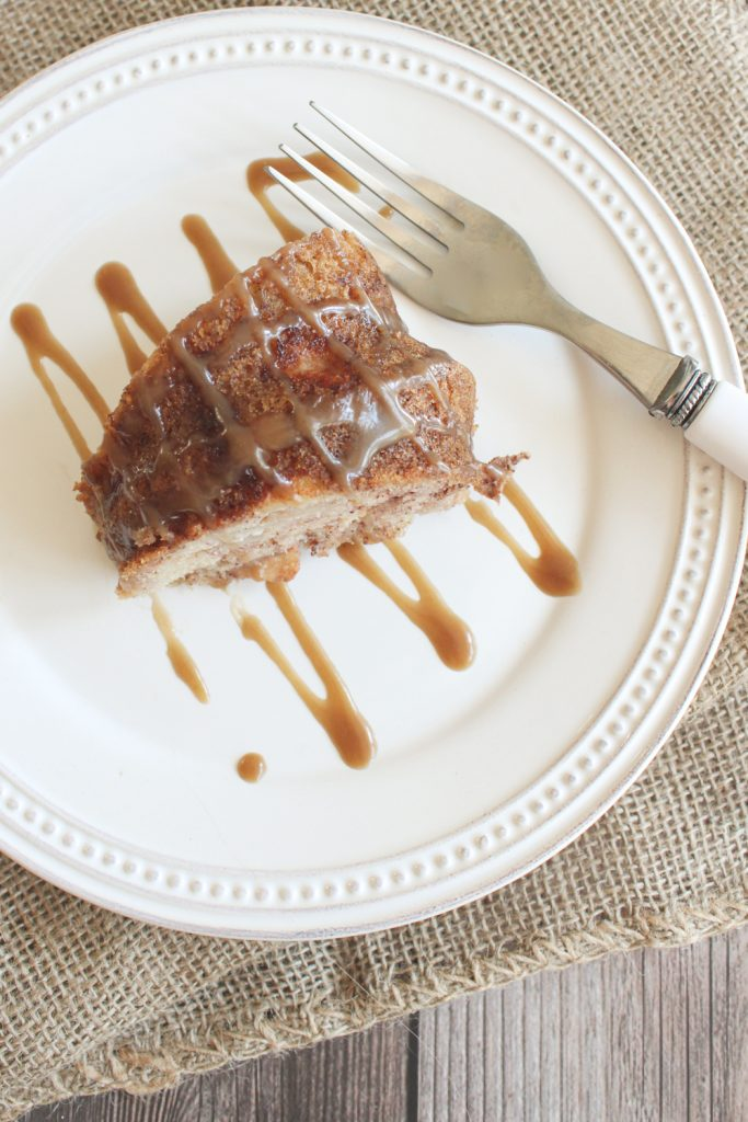overhead of apple cake on plate with caramel