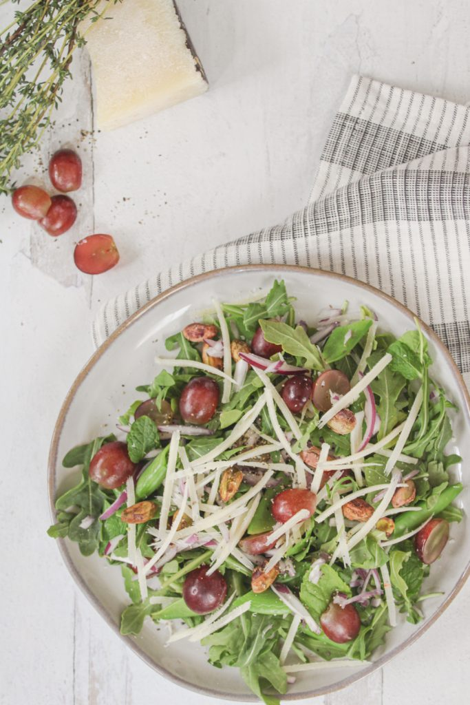 overhead photo of spring salad with grapes and pecorino