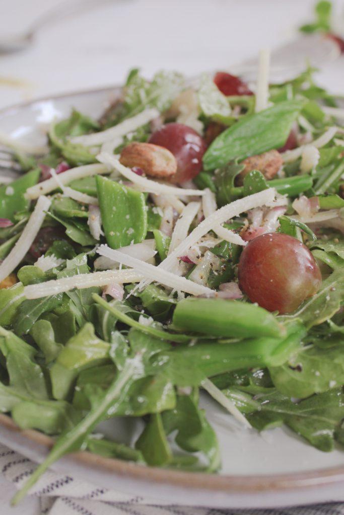 arugula, snap peas, pecorino and grapes in spring salad
