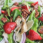close up of mixed strawberry salad with chicken