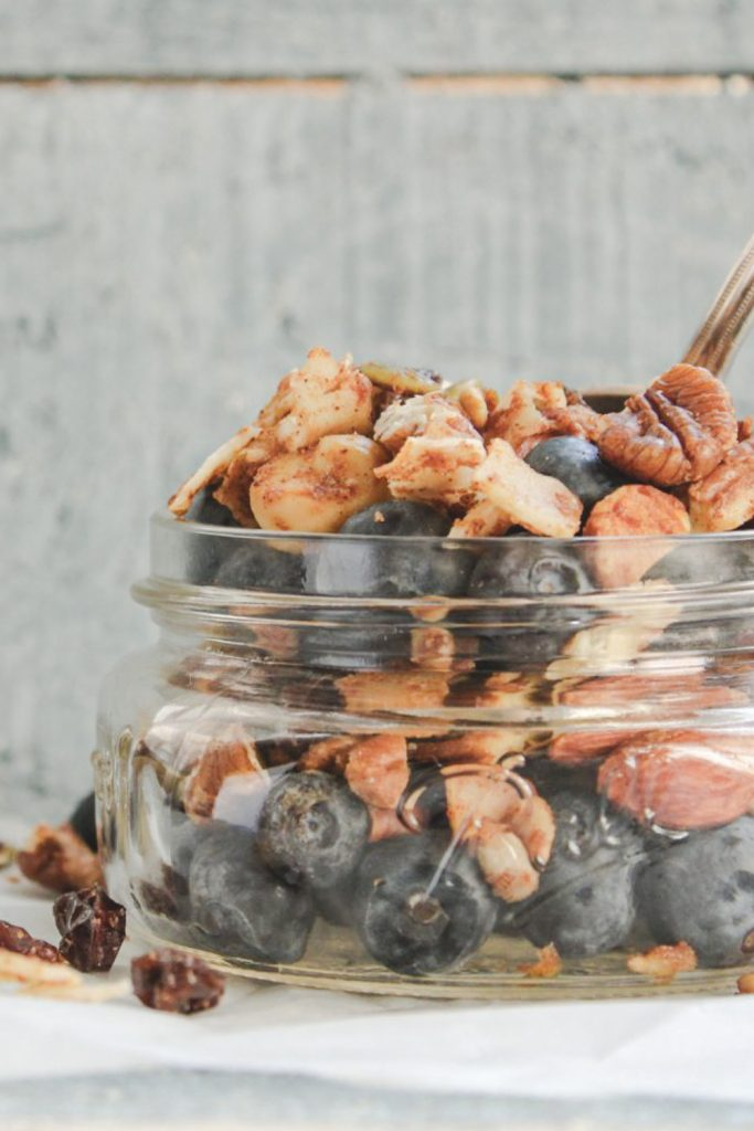 bowl of sweet and spicy trail mix with blueberries