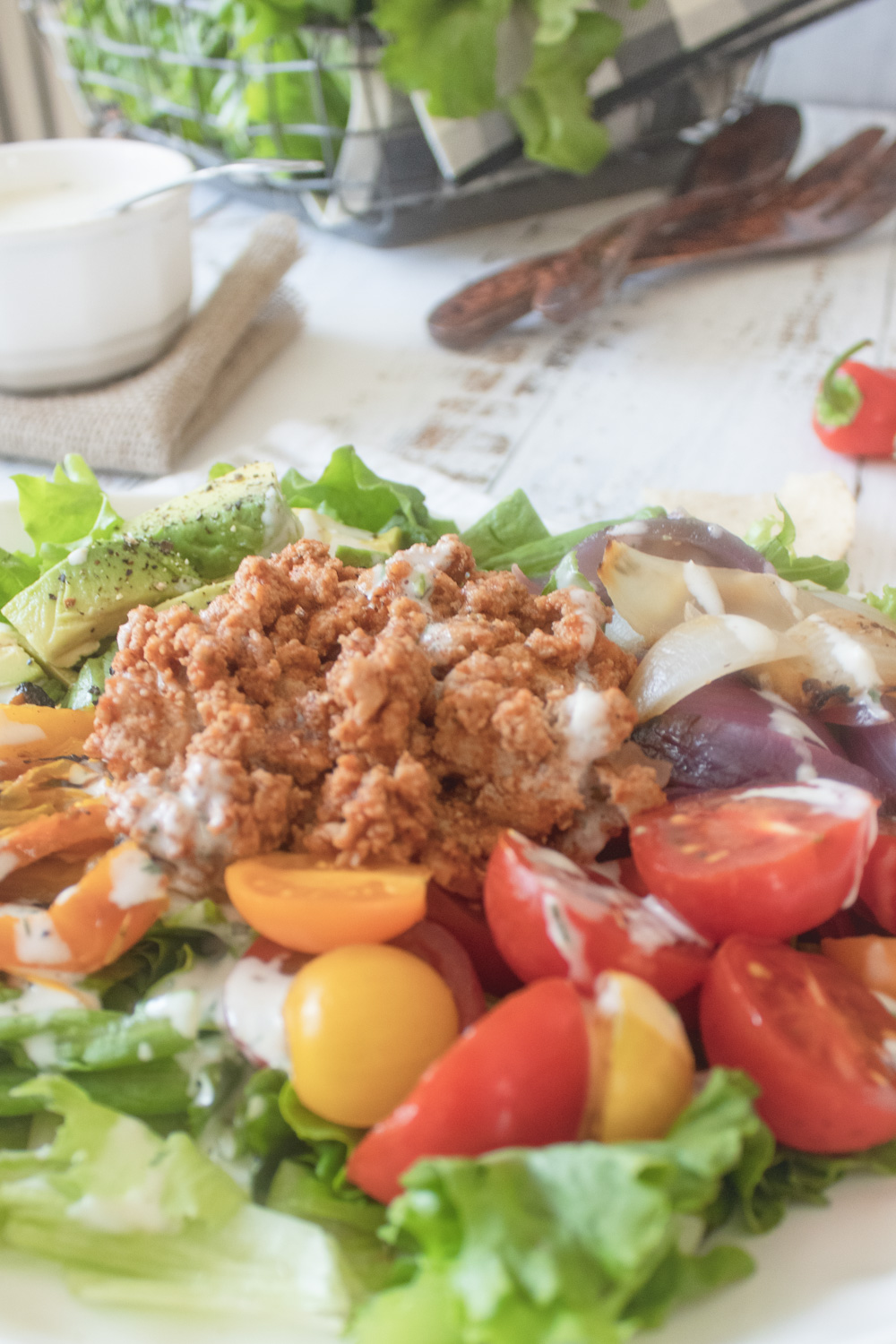 close up of tomatoes and meat in salad