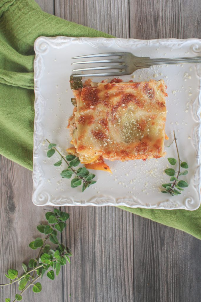 slice of vegetable lasagna with herbs