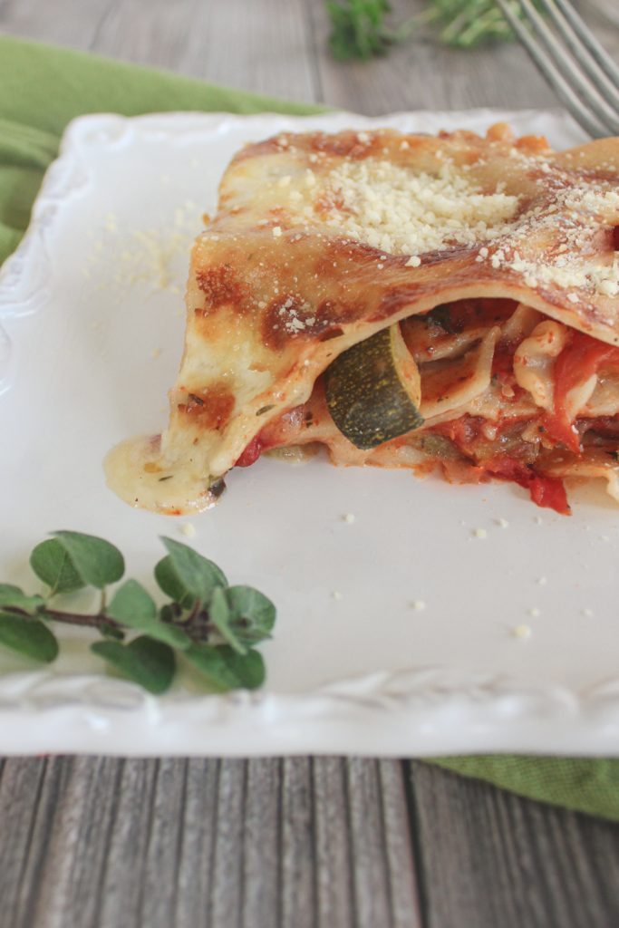 cheese melting off piece of vegetable lasagna
